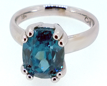 infinity by Denney Blue Zircon Soliatire Ring
